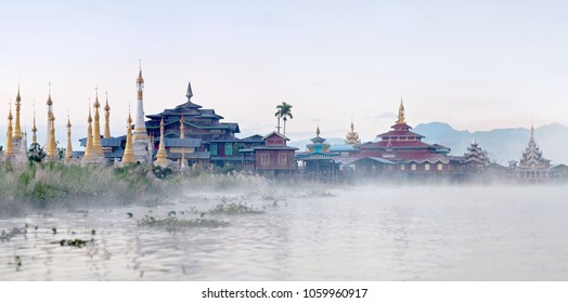 Panorama of ancient buddhist stupa and wooden monastery at sunset on Inle lake, Shan state, Myanmar