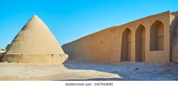 Panorama of the ancient city landmarks - pyramid of yakhchal (ice chamber) and adobe wall of Ghal'eh Jalali fortress, Kashan, Iran