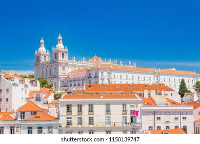 Panorama of ancient Lisbon, Portugal, red tile roofs and monastery Igreja Sao Vicente de Fora, popular tourist destination, beautiful summer day