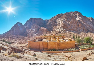 Panorama of the ancient St Catherine Monastery with rocky mountain range, including Mount Sinai, on the background, Egypt.
