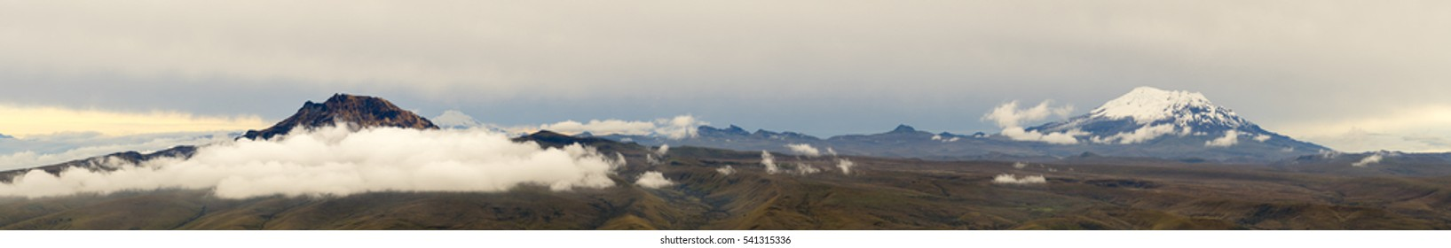Panorama of the Andes showing Sincholagua (left) and Antisana (right) volcanoes. With Cayambe volcano in the distance behind Sincholagua. Viewed from a high point on Cotopaxi Volcano, Ecuador.