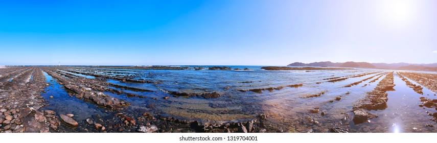 """Panorama of """"Devil's Washboard"""" at Aoshima Island in Miyazaki, Japan"""