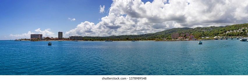 Panorama of the approach to Ocho Rios, Jamaica from the Ocean.