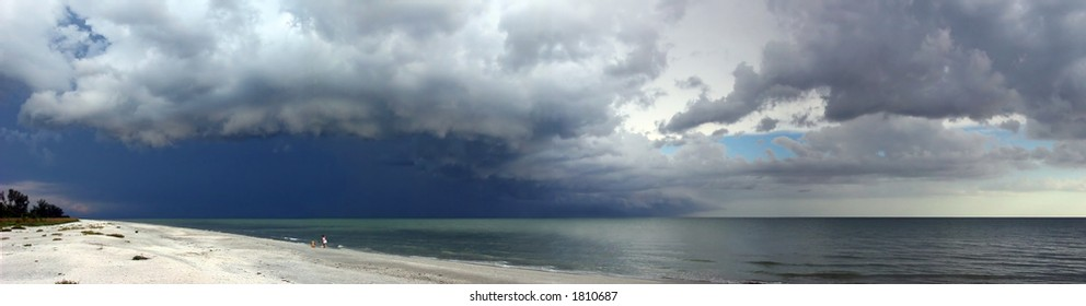 A panorama of an approaching storm over the beach on Sanibel Island, Florida