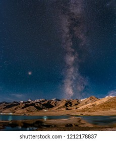 Panorama of arching Milky Way galactic center over the mountain at Pangong Lake or Pangong Tso, Ladakh, Jammu and Kashmir, India.