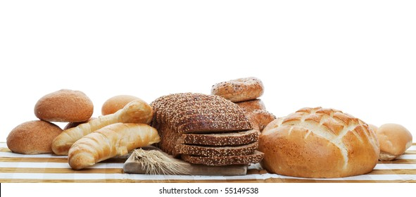 A panorama of assorted baked breads.  Shot on white background.