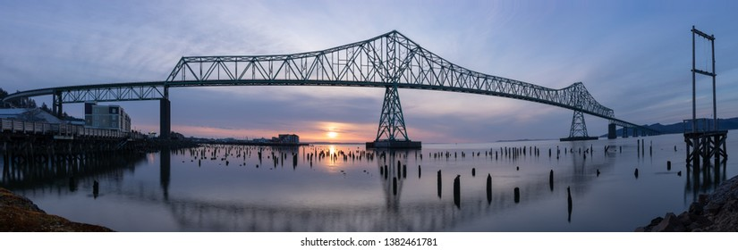 Panorama of the Astoria-Megler Bridge and the Astoria Waterfront at Sunset on a partly cloudy day