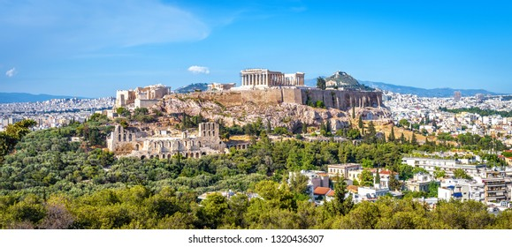 Panorama of Athens with Acropolis hill, Greece. Famous old Acropolis is a top landmark of Athens. Ancient Greek ruins in the Athens center in summer. Scenic view of remains of antique Athens city.