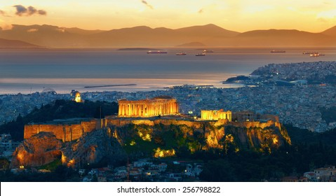 Panorama of Athens, Greece. After sunset. Parthenon and Herodium construction in Acropolis Hill