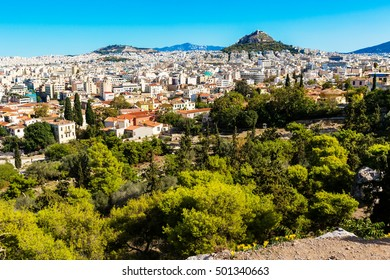 Panorama of Athens, Greece with houses and Lycabettus Hill against blue sky
