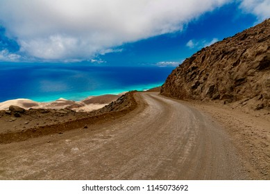 panorama of the Atlantic ocean on the road in the desert of sand and rock and dust in the dud of the island of Fuerteventura