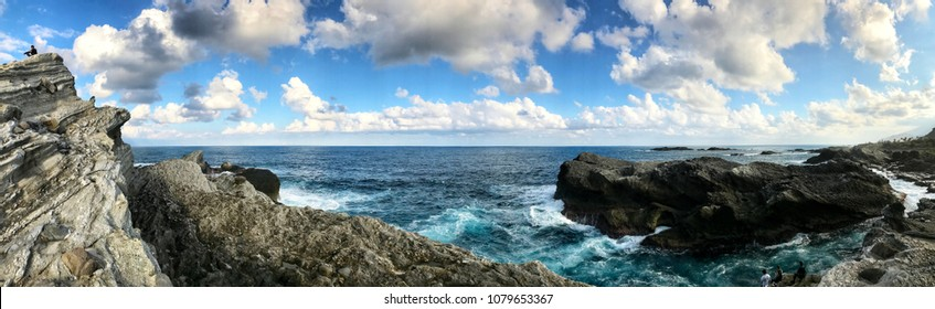 Panorama attractions Pacific scenery seascape of ocean, wave hitting the rock and clear blue sky in Taiwan for nature background.