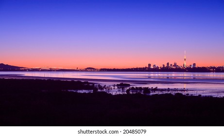 A Panorama of Auckland City, Harbour Bridge and Rangitoto Island at Sunrise
