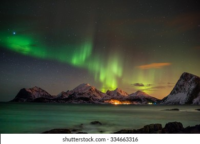 Panorama of the Aurora borealis (Polar lights) over the mountains in the North of Europe - Lofoten Islands, Norway