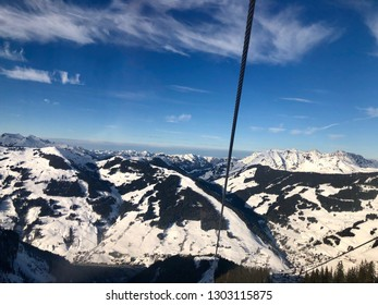 Panorama of the Austrian ski resort of Saalbach-Hinterglemm , Austria, as seen from inside a gondola.