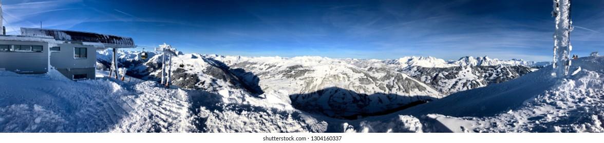 Panorama of the Austrian ski resort of Saalbach-Hinterglemm , Austria with skilift and radio antenna