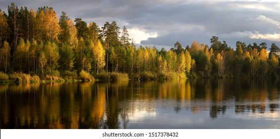 panorama of autumn landscape with forest lake, Russia, Ural
