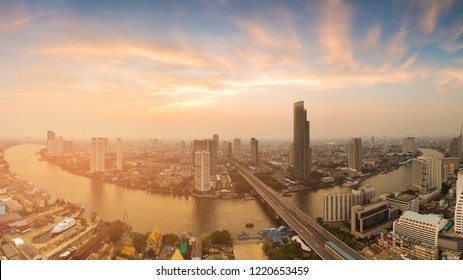 Panorama Bangkok city river curved skyline with after sunset sky, Thailand