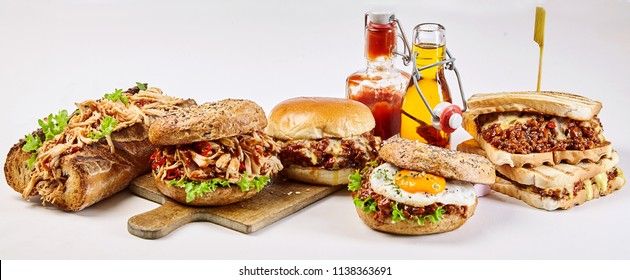 Panorama banner with delicious takeaway food including a pulled chicken burger and baguette, Sloppy Joe sandwich, egg burger and bagel over a white background for advertising