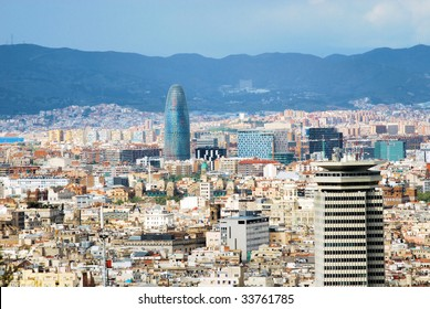 panorama of Barcelona with a kind on a tower and the Pyrenees mountains