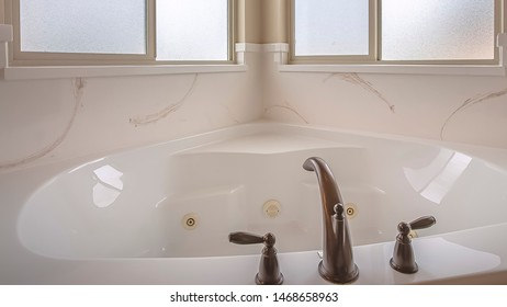 Panorama Bathroom interior of a home with polished bathtub and frosted windows