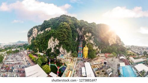PANORAMA The Batu Caves Lord Murugan Statue and entrance near Kuala Lumpur Malaysia. A limestone outcrop located just north of Kuala Lumpur