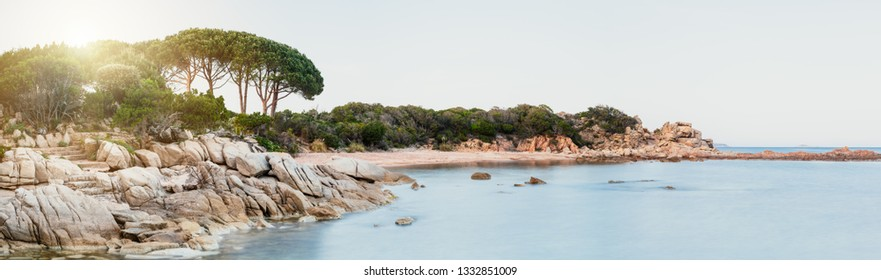 Panorama bay with rocks and green trees with view to the sea and coast in summer at Corisca in France