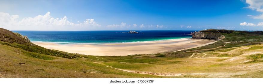 Panorama of beach Anse de Pen-Hat on the Presqu'ile de Crozon, Parc naturel regional d'Armorique. Finistere department, Crozon. Brittany (Bretagne), France.