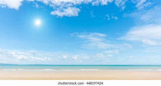 Panorama of beach with blue sky  and sun reflection
