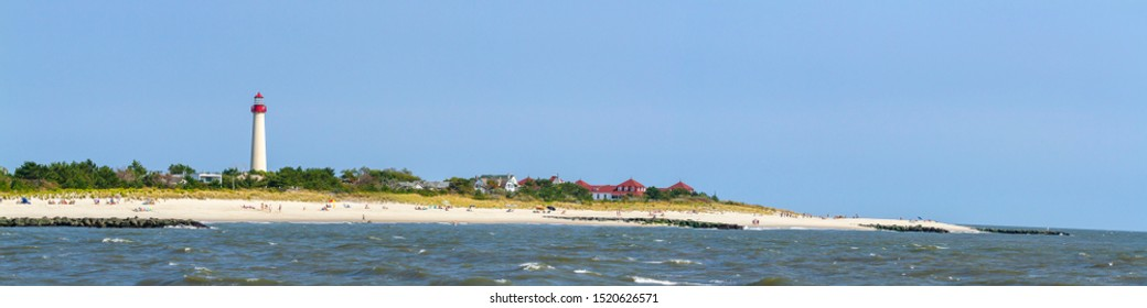 Panorama of beach with Cape May Lighthouse in Cape May, New Jersey.