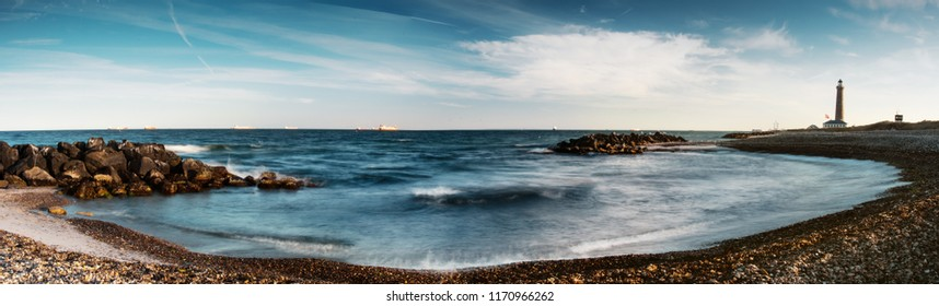 Panorama of the beach coastline with the famous Skagen Grey Lighthouse, Skagen Grå Fyr in colorful , Skagen, Grenen in North Jutland in Denmark, Skagerrak, North Sea, Baltic Sea