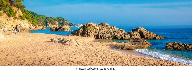 Panorama of beach in Spain. Spanish seascape in Ibiza. Rocks on sea coast
