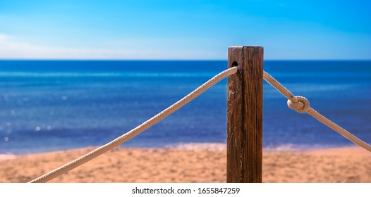 panorama of a beach with a stake and a rope in the foreground