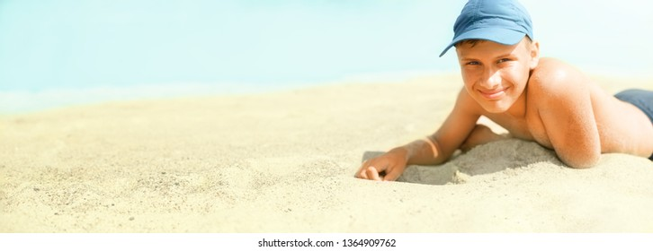 Panorama of the beach view with copyspace and happy child boy lying on sand  image