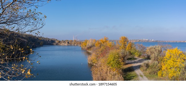 Panorama, beautiful autumn landscape. View of the lake near the Kodak fortress and the Dnieper river against the background of the Dnieper thermal power plant.
