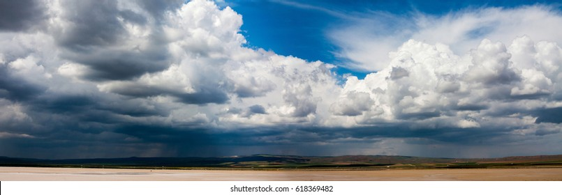 Panorama of beautiful blue and dark sky cloud background. Clouds break up.  Interesting bright sky. Panoramic composition in high resolution.