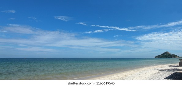 Panorama of beautiful blue sky and sea , see kao takieb hill and fishing boat go to the ocean.