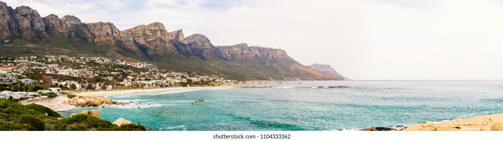 Panorama of beautiful Camps bay in Cape Town with Twelve Apostles mountain range in background