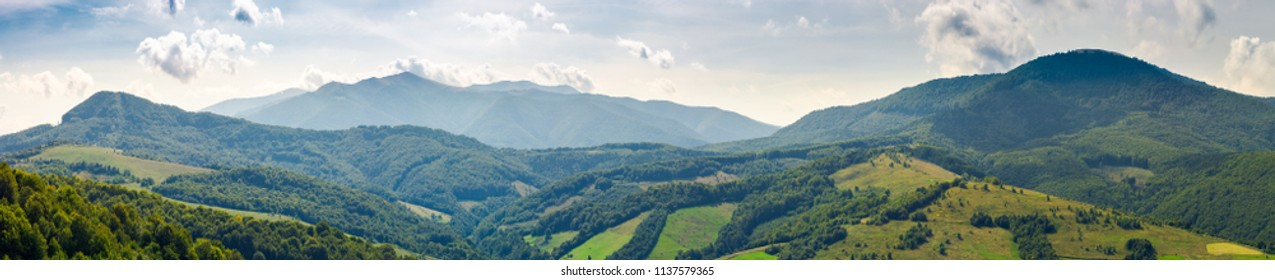 panorama of beautiful Carpathian mountains. perfect countryside landscape. rural field on the nearest forested hills. Mighty Borzhava ridge in the distance