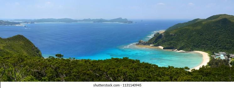 Panorama of a beautiful cove and coral reef at Tokashiku Beach on Tokashiki Island in Okinawa, Japan