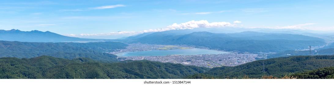 (panorama) Beautiful dawn view of Lake Suwa from Takabocchi mountain in Nagano Prefecture, Japan.