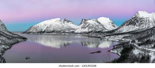 Panorama of the beautiful fjord on Senja island with magical pink light at sunset, Troms county - Norway