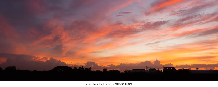 Panorama of beautiful heavenly landscape with sunset sky and clouds