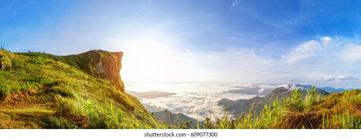 Panorama beautiful landscape nature of sunrise on peak mountain with sun cloud fog and bright sky in winter at Phu Chi Fa Forest Park is a famous tourist attraction of Chiang Rai Province, Thailand