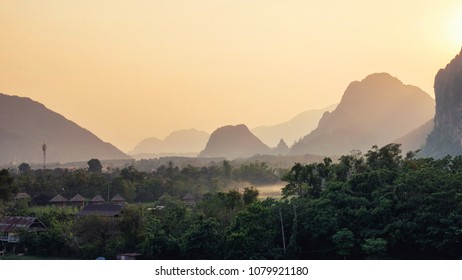Panorama of beautiful Laos landscape from mountain top. Adventure or travel concept on sunset at Song river, Vang Vieng,Laos