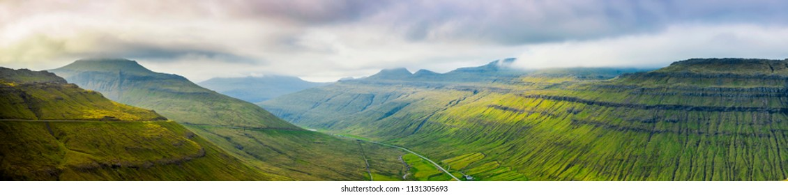 Panorama Of Beautiful Mountain Scene In Faroe Islands