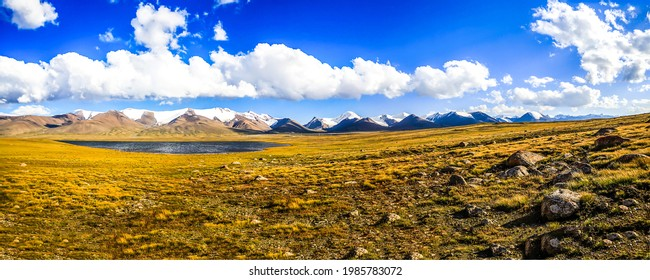 Panorama of a beautiful mountain valley. Mountain valley panoramic landscape. Mountain valley panorama - Shutterstock ID 1985783072