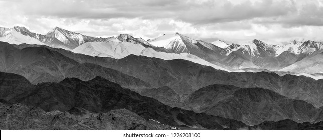 Panorama of the beautiful mountains that surround Leh at sunset. View from Spituk Gompa - Tibet, Kargil, Leh district, Western Ladakh, Jammu and Kashmir, Northern India (black and white)
