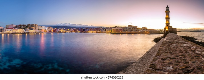Panorama of the beautiful old harbor of Chania with the amazing lighthouse, at sunset, Crete, Greece.