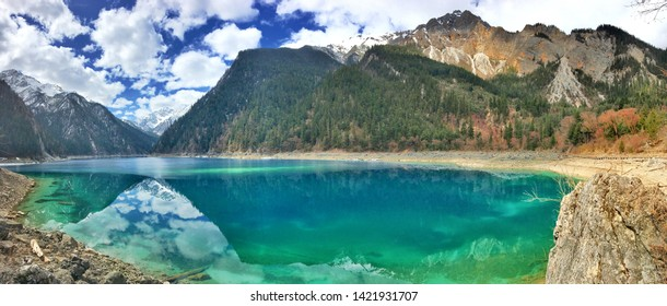 Panorama beautiful scenery of clear turquoise color lake and mountain with the reflection on water surface in Spring at Jiuzhaigou National Park in Sichuan province, China.